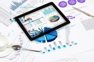 ipad tablet reports data and charts