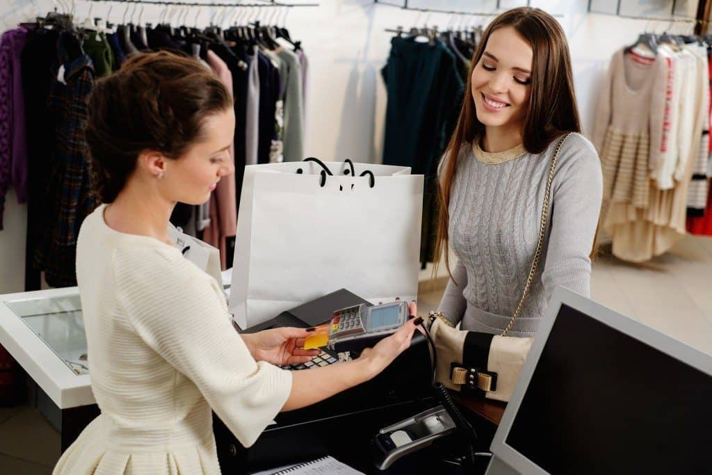 woman paying with EMV terminal hardware