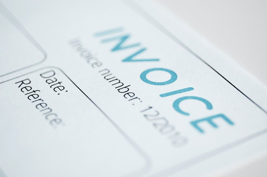 Close-up picture of an invoice light blue tint.