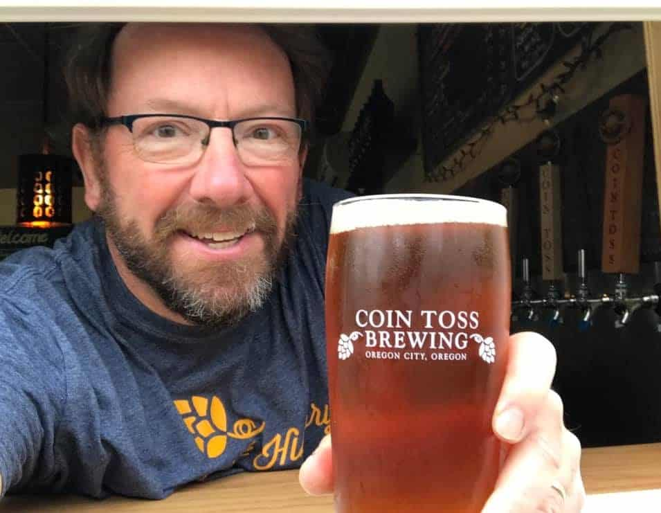 Photo showing Coin Toss Owner Tim Hohl serving out of the taproom's new window